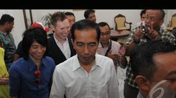 Personel Slank Abdee Negara (kiri) saat menemui Presiden terpilih Jokowi di Balaikota Jakarta (Liputan6.com/Herman Zakharia)