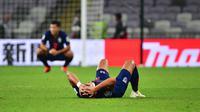 Ekspresi pemain Thailand sesaat setelah kalah 1-2 dari China di babak 16 besar Piala Asia 2019 di Hazza bin Zayed Stadium, Al Ain (20/1/2019). (AFP/Giuseppe Cacace)