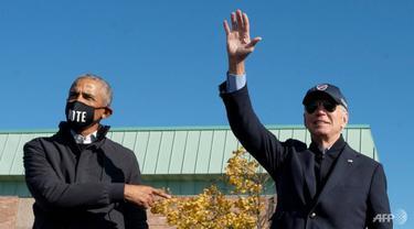 Mantan presiden Amerika Serikat Barack Obama berkampanye dengan calon presiden dari Partai Demokrat Joe Biden di Flint, Michigan, pada 31 Oktober 2020. (Foto: AFP / Jim Watson)