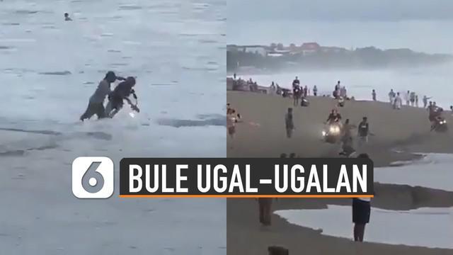 Video beberapa bule ugal-ugalan kendarai motor di pantai viral di media sosial.