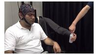 Brain-controlled Robotic Arm (Sumber: Mashable)