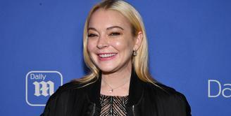 Lindsay Lohan mengatakan ia ingin mengadopsi anak usai menghabiskan waktu dengan pengungsi Suriah di Turki. (SLAVEN VLASIC  GETTY IMAGES NORTH AMERICA  AFP)