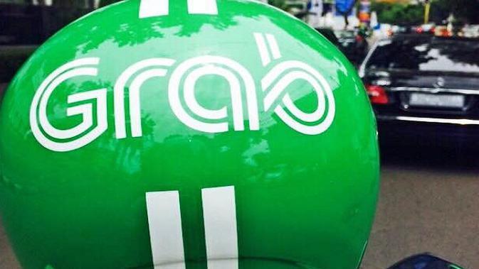 Ilustrasi Driver Grab dengan Helm Baru (Liputan6.com/Jeko Iqbal Reza)