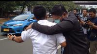 Mantan pilot Citilink usai pemeriksaan di BNN. (Liputan6.com/Muhammad Radityo Priyasmoro)