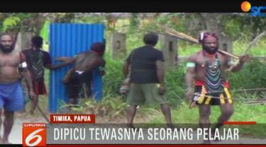 Dua kelompok warga bersenjata busur dan panah saling serang di jalan raya