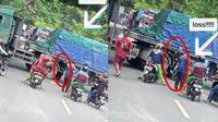 Aksi nekat pengendara motor terobos kolong truk trailer (Sumber: TikTok/riki_rfldi)