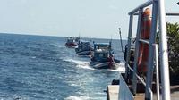 Kementerian Kelautan dan Perikanan (KKP) kembali menangkap enam kapal perikanan asing (KIA) ilegal berbendera Vietnam (Foto: KKP).