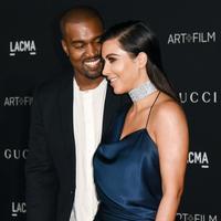 Cinta Kanye West untuk Kim Kardashian memang terlihat jelas. Keluarga mereka pun bisa dibilang harmonis. (REX/Shutterstock)