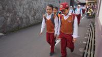 Program Walk to School yang berjalan di Kota Bandung dinilai tak hanya bisa mengurangi kemacetan, tetapi juga bisa mendatangkan kegembiraan. (Liputan6.com/Huyogo Simbolon)