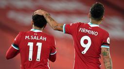 Roberto Firmino. Gelandang serang Liverpool ini mengenakan nomor punggung 11 di awal kedatangannya pada 2015/2016 hingga 2016/2017. Usai kedatangan Mohamed Salah pada 2017/2018 ia memberikan nomor tersebut kepada Salah dan mengganti nomornya menjadi 9 hingga kini. (Foto: AFP/Pool/Peter Powell)