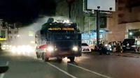 Satgas juga melakukan penyemprotan disinfektan massal di sejumlah lokasi di Kota Manado, pada Minggu malam (13/12/2020).