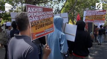 Ratusan Aktivis menggelar demo anti IMF-WB mereka menentang diadakannya pertemuan IMF_WB di Bali. Menurut mereka pertemuan imf-wb hanya menguntungkan korporasi