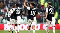 Penyerang Juventus, Paulo Dybala, mencetak gol saat bersua Brescia pada laga pekan ke-24 Serie A di Allianz Stadium, Minggu (16/2/20202) malam WIB. Juve pun menang 2-0 atas Brescia. (AFP/Isabella Bonotto).