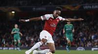Penyerang Arsenal, Pierre-Emerick Aubameyang, menilai timnya masih perlu berbenah meskipun meraih kemenangan 4-2 atas Vorskla Polta pada matchday pertama Liga Europa 2018-2019. (AFP/Ian Kington)