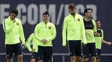 Pemain-pemain Barcelona tampak sedang serius berlatih mempersiapkan diri meghadapi Bayern Muenchen. (AFP PHOTO/ LLUIS GENE)