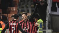Gelandang serang AC Milan, Lucas Paqueta merayakan gol ke gawang Cagliari pada pekan ke-23 Serie A di San Siro, Minggu (10/2/2019) malam waktu setempat. (Marco BERTORELLO / AFP)