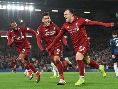 Liverpool memiliki catatan kebobolan hanya 22 kali pada Liga Inggris musim 2018/2019. Catatan itu tak lepas dari jasa penjaga gawang mereka, Alisson yang berhasil torehkan 21 clean sheet. Pada musim itu, The Reds berhasil menempati urutan kedua. (Foto: AFP/Paul Ellis)