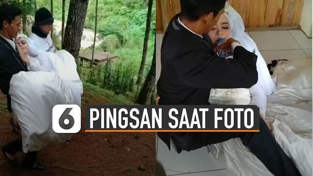 Seorang calon pengantin perempuan pingsan saat foto pre wedding di atas bukit.