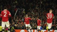 Penyerang Manchester United,  Marcus Rashford berselebrasi usai mencetak gol ke gawang Atalanta pada pertandingan lanjutan Grup F Liga Champions di Old Trafford, Inggris, Kamis (21/10/2021). MU menang tipis atas Atalanta 3-2. (AP Photo/Dave Thompson)