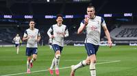 Bintang Tottenham Hotspur, Gareth Bale, merayakan gol ketiga yang dicetaknya ke gawang Sheffield United dalam laga pekan ke-34 Premier League di Tottenham Hotspur Stadium, Senin (3/5/2021) dini hari WIB. Gareth Bale mencetak hattrick dan Spurs menang telak 4-0. (SHAUN BOTTERILL / POOL / AFP)