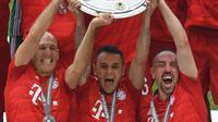 Tiga pemain senior Bayern Munchen, Arjen Robben, Rafinha, dan Franck Ribery, memutuskan pergi pada akhir musim ini. (AFP/Christof Stache)