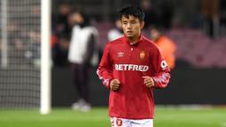 2. Takefusa Kubo (Villarreal) - Pemain asal Jepang ini dipinjamkan Real Madrid ke Villareal untuk terus mengasah kemampuannya. Takefusa Kubo mempunyai bakat luar biasa, ia pemain yang lincah dalam memberikan assist. (AFP/Josep Lago)
