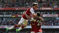 Nacho Monreal cetak gol pertama saat Arsenal cukur West Ham United ( IAN KINGTON / AFP)