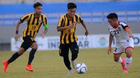 Duel Malaysia vs Brunei di penyisihan Grup B Piala AFF U-19 2018 di Stadion Gelora Joko Samudro, Gresik, Jumat (6/7/2018). (Bola.com/Zaidan Nazarul)