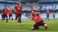 Bruno Fernandes merupakan gelandang andalan Manchester United saat ini. Diboyong dari Sporting CP dengan harga 63 juta euro pada Januari 2020 lalu, Fernandes berhasil tampil impresif dengan mencetak 43 gol dan 25 assist dari 83 pertandingan. (Foto: AFP/Pool/Laurence Griffiths)