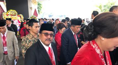 Mantan Gubernur Banten Rano Karno sebelum pelantikan anggota DPR. (Liputan6.com/Delvira Hutabarat)