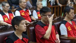 Terdakwa kasus penyeludupan 1 ton sabu asal Taiwan menjalani sidang tuntutan di Pengadilan Negeri Jakarta Selatan, Rabu (7/3). Para terdakwa terancam dengan hukuman mati. (Liputan6.com/Immanuel Antonius)