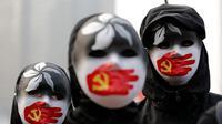 Unjuk rasa damai di Hong Kong mendukung warga Uighur China berujung bentrok. (Lee Jin-man/AP Photo)