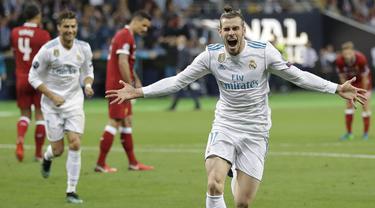 Penyerang Real Madrid, Gareth Bale, melakukan selebrasi usai mencetak gol ke gawang Liverpool pada laga final Liga Champions di Stadion NSC Olimpiyskiy, Kiev, Minggu (27/5/2018). Real Madrid menang 3-1 atas Liverpool. (AP/Sergei Grits)