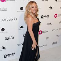 """""""Mariah memberikan Bryan sekitar Rp 300 Juta setiap bulan jadi dia (Bryan) dapat membelikannya hadiah,"""" ucap sumber yang dilaporkan Aceshowbiz. (AFP/TIBRINA HOBSON)"""