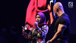 Presenter Deddy Corbuzier bersama selebgram Ria Ricis saat jadi pembicara di  XYZ DAY 2018  di The Hall Senayan City, Jakarta, Rabu (25/4). XYZ Day diselenggarakan oleh KapanLagi Youniverse. (Liputan6.com/Herman Zakharia)
