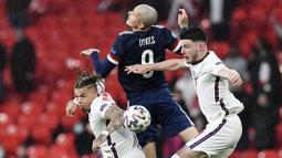 Tim lawan juga bermain cukup percaya diri. Meski kalah dalam penguassan bola, Skotlandia dengan tenang meladeni permainan Inggris dan beberapa kali melakukan serangan balik. (Justin Tallis/Pool via AP)