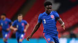 2. Bukayo Saka (19 tahun) - Bukayo Saka tampil apik bersama timnas Inggris pada laga persahabatan dan UEFAN Nations League. Pemain klub Arsenal ini turut menyumbangkan satu asists dari tiga laganya bersama timnas Inggris. (AFP/Ben Stansall/pool)