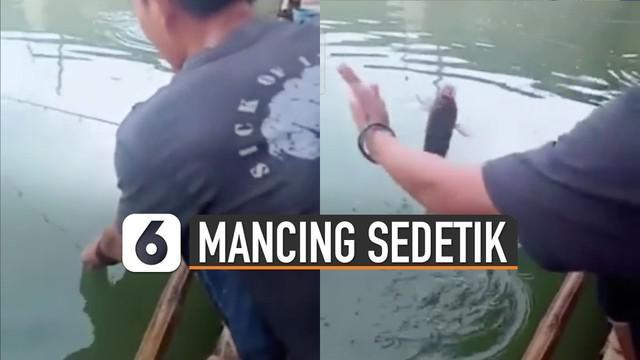 Aksi unik di sebuah kolam pemancingan dipertontonkan pria satu ini.