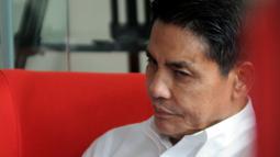 Dirut PT Pupuk Indonesia Holding Company Aas Asikin Idat usai menjalani pemeriksaan di Gedung KPK, Jakarta, Selasa (14/5/2019). Sebelumnya, Aas pernah dipanggil oleh KPK pada Senin, 6 Mei 2019. (merdeka.com/Dwi Narwoko)