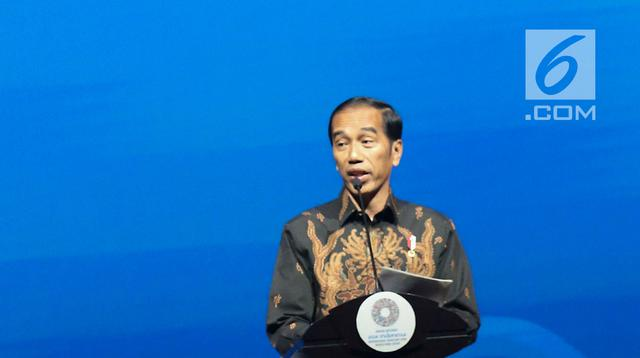 Presiden Joko Widodo saat berpidato dalam Bali Fintech Agenda IMF-WB 2018 di Nusa Dua, Bali, Kamis (11/10). Jokowi mengaku mengacu pada kebijakan Amerika Serikat (AS) yang merupakan negara kelahiran internet. (Liputan6.com/Angga Yuniar)