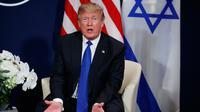 Presiden AS Donald Trump di sela Forum Ekonomi Dunia, Davos (25/1). Dalam pertemuannya Trump mengatakan Palestina sudah 'tidak menghormati' terkait keputusan kontroversialnya mengakui Yerusalem sebagai ibu kota Israel. (AP Photo / Evan Vucci)