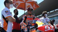 Pembalap Repsol Honda, Marc Marquez jelang balapan MotoGP Portugal di Sirkuit Portimao, Minggu (18/04/2021). (PATRICIA DE MELO MOREIRA / AFP)