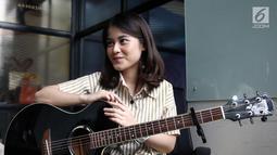 """Penyanyi Ashira Zamita saat wawancara di kantor KLY, Gondagdia, Jakarta, Senin (1/10). Ashira telah mengeluarkan single terbaru """"Ku Cinta Nanti"""" yang dirilis serentak bersamaan dengan video clip pada 14 September 2018. (Liputan6.com/Herman Zakharia)"""