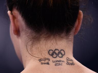 Vanessa Ferrari - Atlet Itali tersebut membuat tato lambang Olimpiade sebagai bentuk apresiasi dirinya yang telah mengikuti beberapa kali Olimpiade seperti di Beijing, London, dan Rio. (Foto: AFP/Loic Venance)