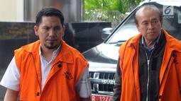 Tersangka Bupati Bener Meriah nonaktif Ahmadi dan kontraktor Susilo Prabowo alias bun tiba di gedung KPK, Jakarta (25/7/18). Ahmadi diperiksa terkait dugaan suap proyek infrastruktur dari dana Otonomi Khusus Aceh Anggaran 2018. (Merdeka.com/Dwi Narwoko)
