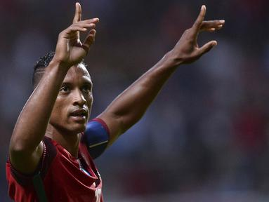 Kapten Portugal, Nani, merayakan gol yang dicetaknya ke gawang Gibraltar pada laga persahabatan di Stadion Bessa, Porto, Portugal, Kamis (1/9/2016). Portugal menang 5-0 atas Gibraltar. (EPA/Hugo Delgado)