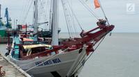 Kapal Pinisi Bakti Nusa bersandar di dermaga Pelabuhan Gorontalo, Sulawesi Utara, Rabu (16/1). Kapal Pinisi Bakti Nusa memiliki panjang 28 m dan lebar 6 m ini dibuat dengan menghabiskan dana Rp 2,7 miliar. (Liputan6.com/ Arfandi Ibrahim)