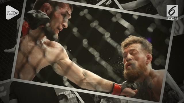 Khabib Nurmagomedov berhasil mempertahankan gelar juara dunia kelas ringan UFC setelah menang submission atas Conor McGregor di ronde keempat pada pertarungan di Las Vegas.