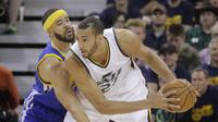 Rudy Gobert  saat melawan Golden State Warriors pada babak Semifinal NBA, Senin (8/5/2017) (AP Photo/Rick Bowmer)