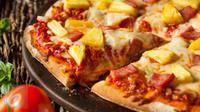 Ini 4 cara zaman now menyantap pizza dengan seru. (Foto: Istockphoto)
